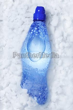soda bottle in snow