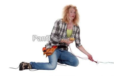 a shocked female electrician