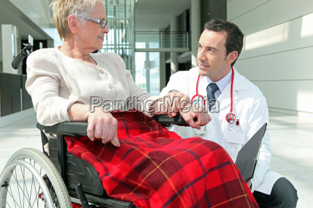 doctor talking to a woman in