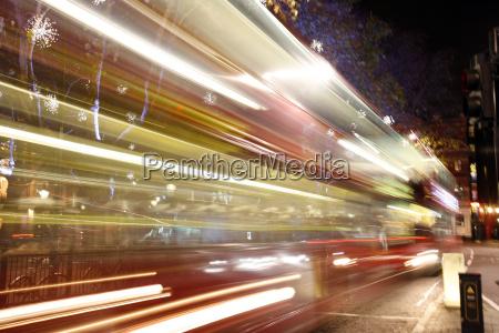 dobule decker bus at night