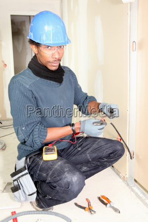 electrician taking measurements
