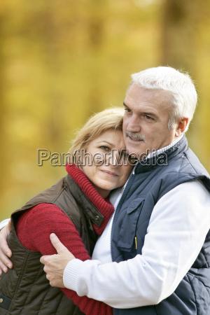 mature couple on an autumn walk