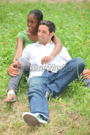 mixed race couple in park