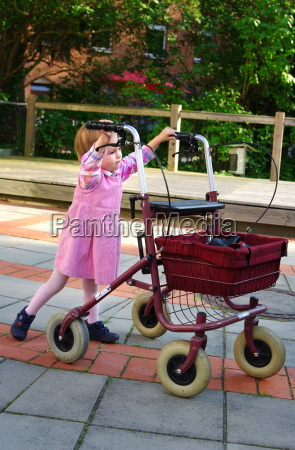 child plays with a rollator