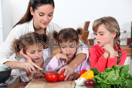 mother and her daughters making salad