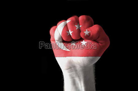 fist painted in colors of singapore