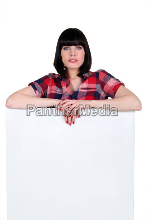 brunette with a board left blank