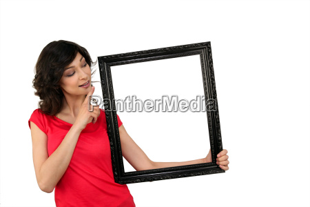 young woman and a wooden frame