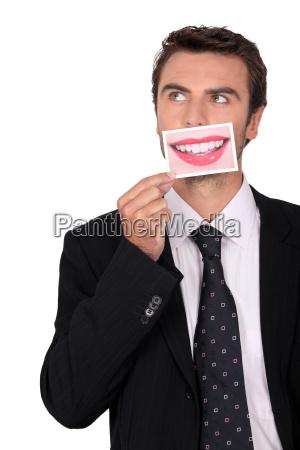 man pretending he has woman lips