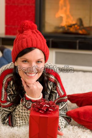 christmas present woman lying floor home