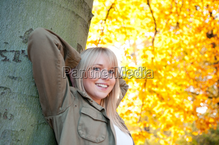 young, woman, stands, on, a, tree - 5968919