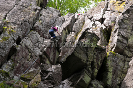 climbing on the stone wall rhoen