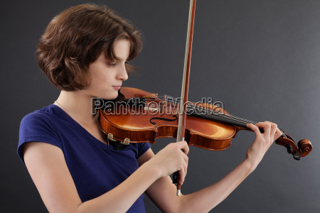 young female playing the violin