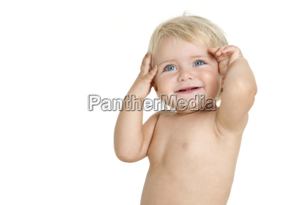 infant with hands on head