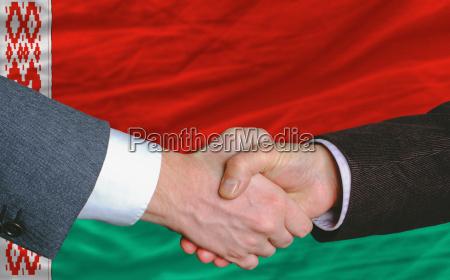 businessmen handshakeafter good deal in front