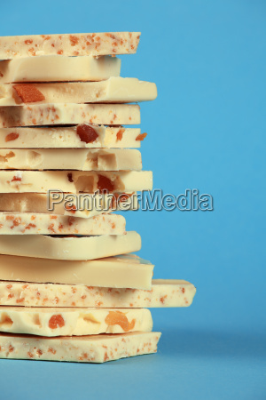 white chocolate stack on blue background