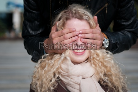 who is it covering eyes