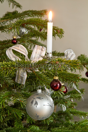 christmas tree decorations with candle as