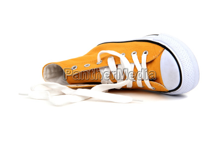 yellow sneaker with white latchet on