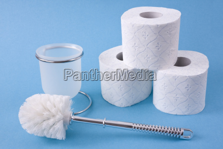 toilet brush and toilet paper rolls