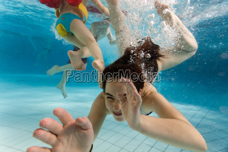 children swimming underwater
