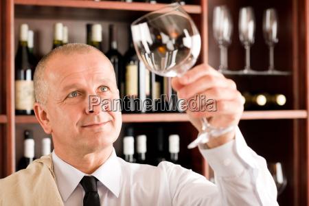 wine bar waiter clean glass looking
