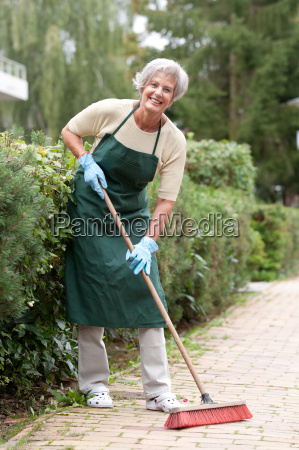 active senior with a broom