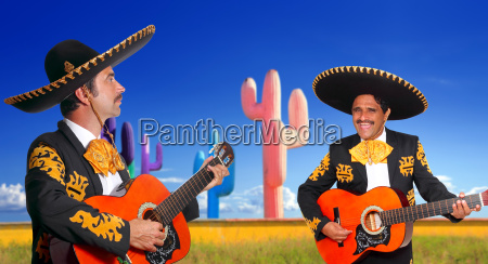 mexican mariachi charro playing guitar in