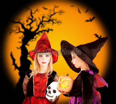 halloween children girls with tree and