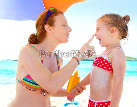 daughter and mother in beach with