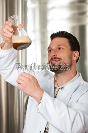 brewmaster for beer in his brewery