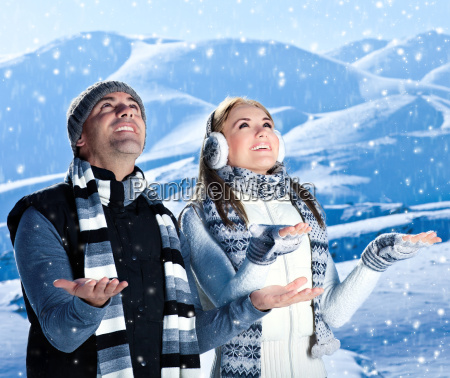 happy couple playing outdoor at winter