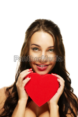 beautiful laughing woman holding red heart