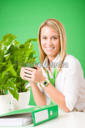 green business woman in office smiling