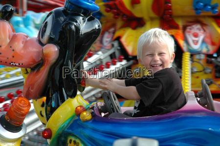 boy drives carousel