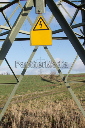 electricity pylons with sign