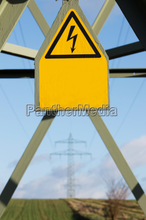 electricity pylon with information sign