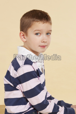 young boy sitting and looking into