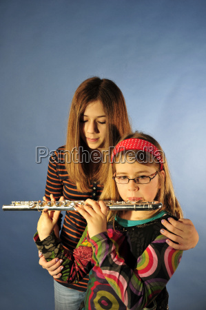 girl with flute and support