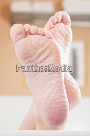 feet on the edge of a