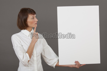 thinking woman with white board