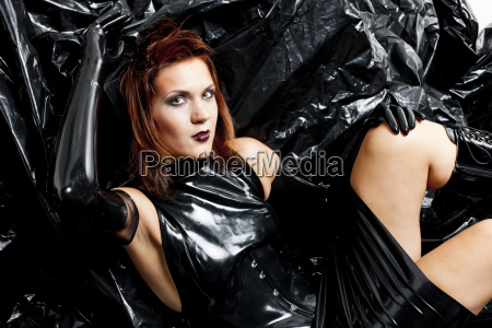 portrait of sitting woman wearing latex