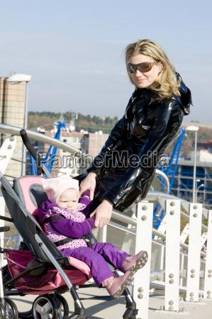 woman with toddler sitting in pram