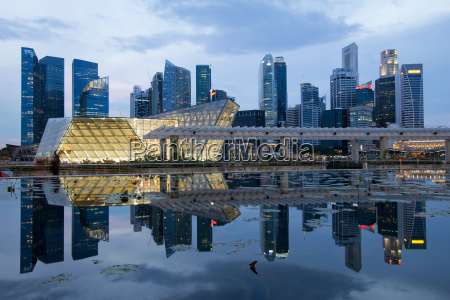 reflection of singapore city skyline at