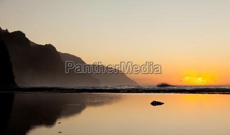 misty sunset on na pali coastline