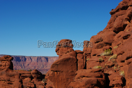 red rock formations near fisher towers