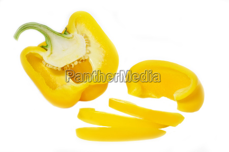 sliced yellow peppers on a white