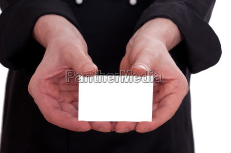 white business card and two hands