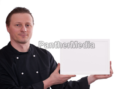 chef holds up a white photo