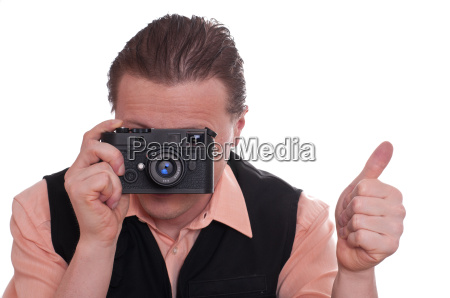 photographer with camera is holding thumbs